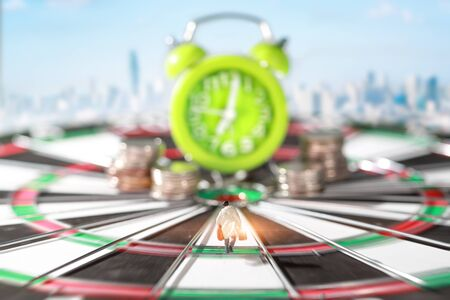 Miniature people: businessman running on dart board and try to race against time and beat the clock to be a winner Stok Fotoğraf - 132392618