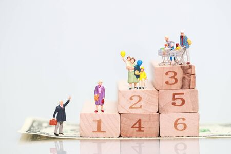 Miniature people: businessman standing on wood block stacking, Financial and Business growth concept using as background