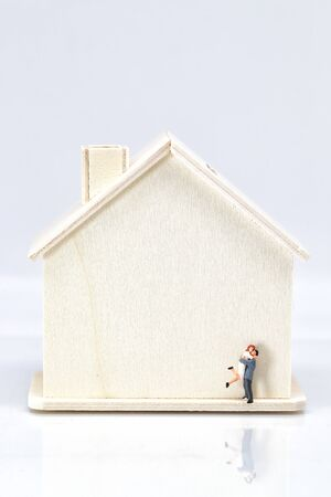 a couple standing beside house Stok Fotoğraf
