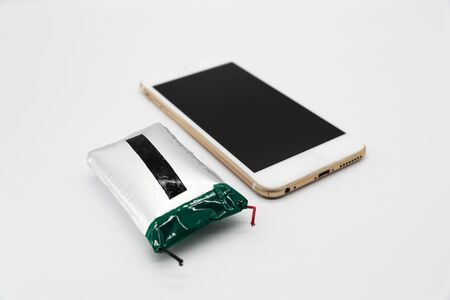 broken power bank with smart phone isolated and white background Stok Fotoğraf - 132392737