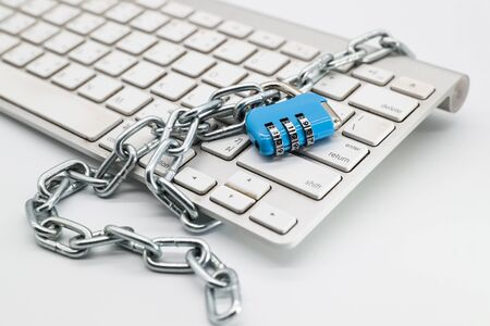 chain locked with password protection on computer keyboard (this image for security technology concept) Stok Fotoğraf