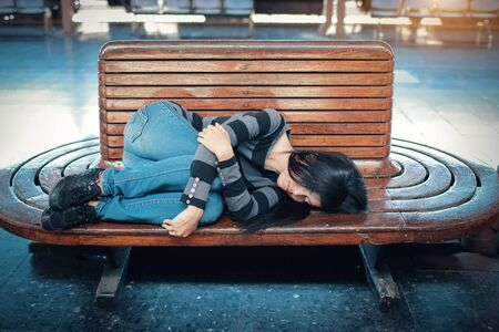 young traveler woman with backpack sleeping and waiting for train Stok Fotoğraf