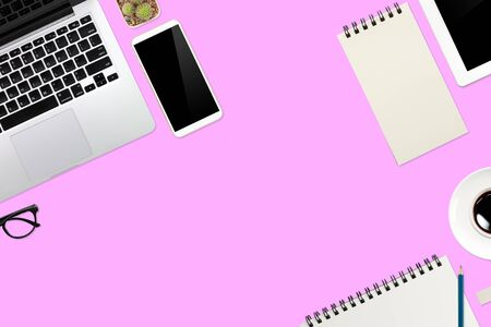 flat lay or top view workspace office pink desk with laptop computer, coffee cup and smartphone using for business background Reklamní fotografie