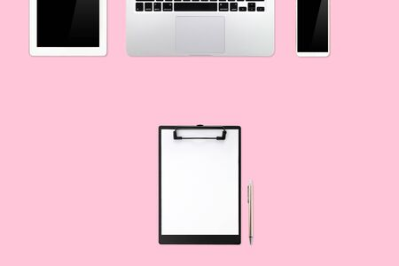 flat lay or top view workspace office pink desk with laptop computer, coffee cup and smartphone using for business background Stok Fotoğraf - 132000927