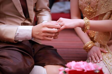 wedding ring on human hand (Thai culture)