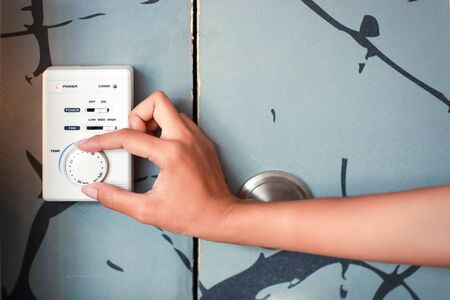 woman hand using thermostat
