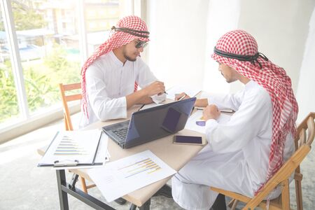 arab saudi businessman signing contract using as business background (concept of teamwork and partnership)
