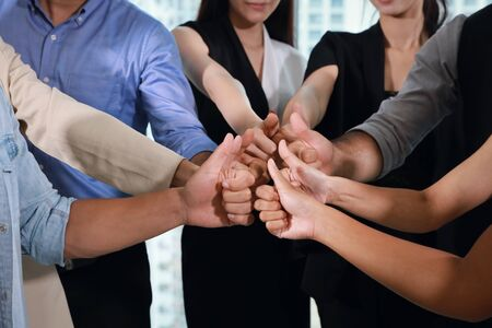 Close up of multiethnic business people hands thumb up together meaning of teamwork or success business concept Stock Photo