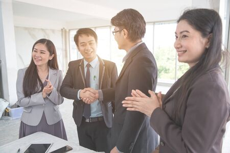 business people shaking hand after completed project during meeting using as background (concept of teamwork and partnership)