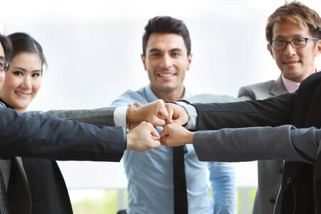 success business deal with fist bump business people hands (teamwork or partnership concept)
