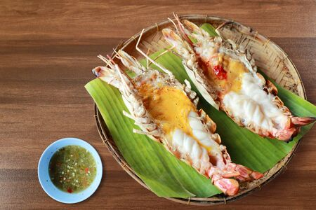 Thai seafood shrimps river burned with spicy sauce on wooden table Reklamní fotografie