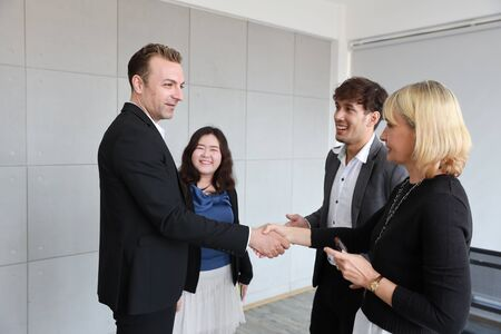 success business deal with handshaking image of businessman and businesswoman