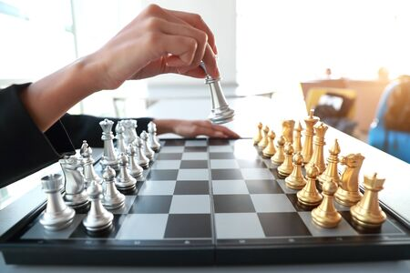 Businesswoman hands playing chess board game idea of management strategy and leadership concept