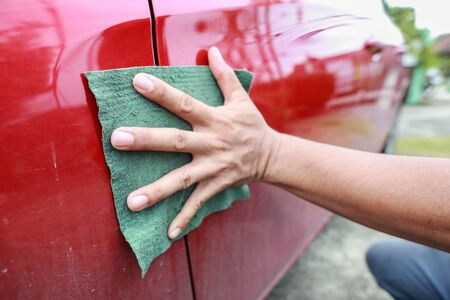 man hand cleaning car Stock Photo