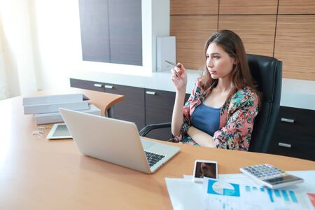 beautiful businesswoman post thinking with labtop computer