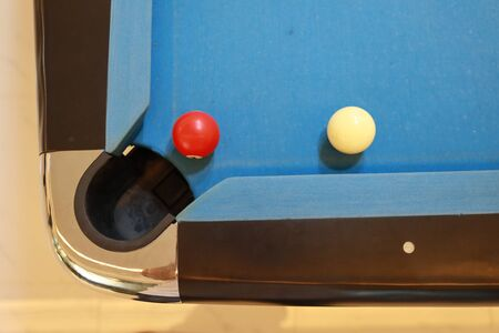 red and white billiard ball on blue pool table Stok Fotoğraf