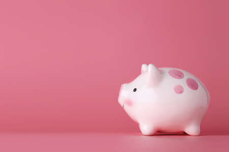 Pink piggy bank on isolated and pink background studio, meaning of saving or earning money or business investment for advertising concept.