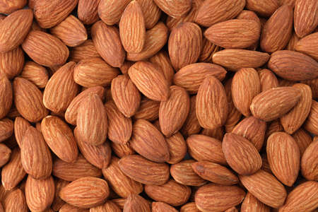 Close up peeled almonds nuts background top view using for your advertising Stok Fotoğraf