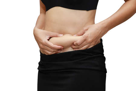 Closeup woman measuring stomach fat with her hands isolated and white background with clipping path