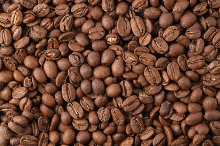 Freshly roasted coffee beans background top view using for your advertising