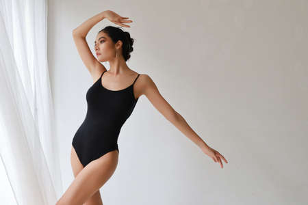 young beautiful asian woman ballet dancer on white wall studio Stockfoto