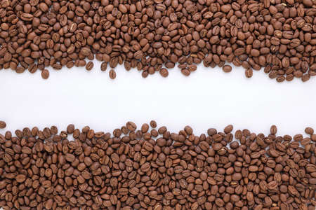 Freshly roasted coffee beans background top view isolated on white background with top copy space using for your advertising