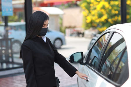 Close up young woman opening or closing car or automobile door