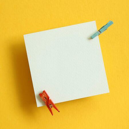 Memo pad on yellow background