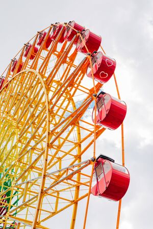 Ferris wheel with cloudy sky in Kobe, Japan Stock Photo