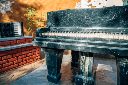 Old piano at Indian folk village Shilpgram in Udaipur, India Stock Photo
