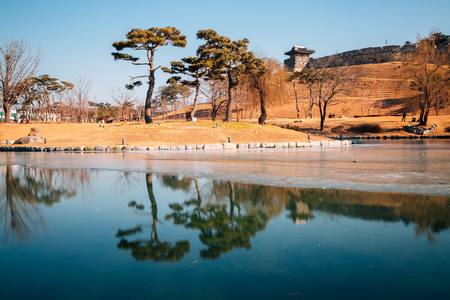 Hwaseong Fortress and frozen pond at winter in Suwon, Korea Stock Photo