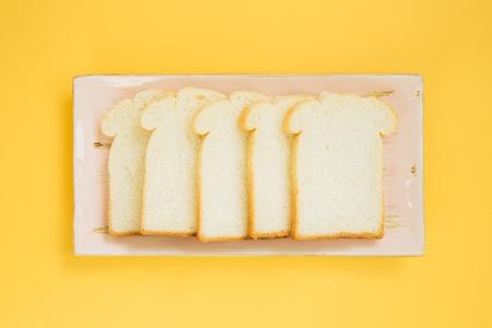 Sliced plain bread on dish
