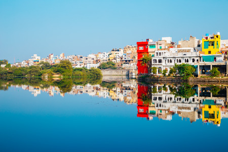 Pichola lake and old buildings in Udaipur, India