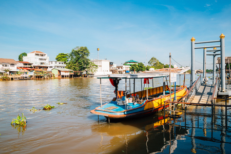 Old boat and Pa Sak River at Ayutthaya train station pier in Thailand