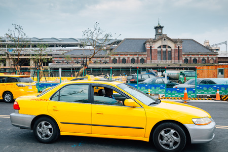 Taichung, Taiwan - May 3, 2018 : Old Taichung railway station and yellow taxi
