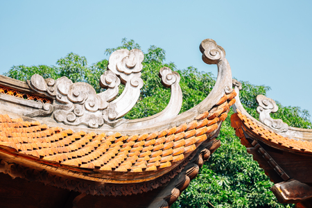 Traditional roof at Temple of literature in Hanoi, Vietnam Stock Photo