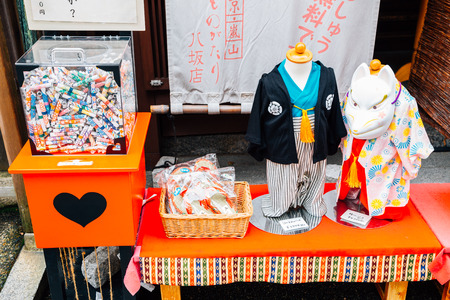 Kyoto, Japan - September 27, 2018 : Japanese traditional kimono for children and Omikuji box at Higashiyama old street