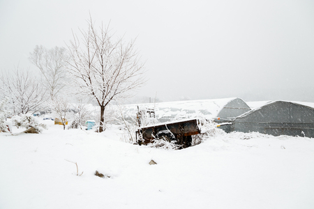 Snow covered rural farm village at Winter Stok Fotoğraf