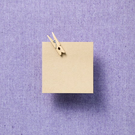 Empty memo paper, sticky notes on purple fabric background Stock Photo - 116354456