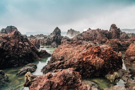 Socheonji rocks and sea in Jeju Island, Korea Stock Photo