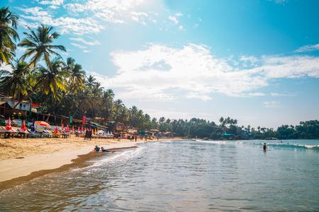 Goa, India - December 21, 2017 : Palolem beach with tropical palm trees