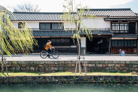 Okayama, Japan - April 15, 2019 : Kurashiki Bikan Historical Quarter, canal and traditional house