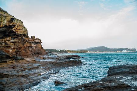 Yongmeori Beach sandstone cliff rock formation in Jeju Island, Korea