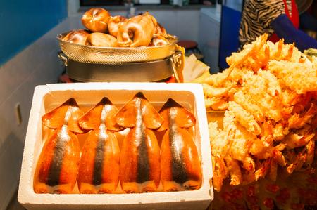 Stuffed Squid (Ojingeo Sundae) and Deep Fried Shrimps (Tempura Shrimps) at Daepo harbor in Sokcho, Korea