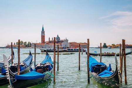 Venice, Italy - August 18, 2016 : Church of San Giorgio Maggiore island and gondolas