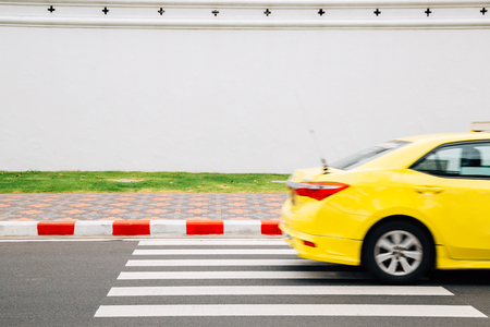 Yellow taxi on crosswalk road