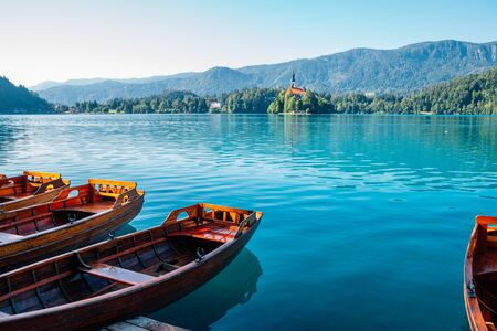 Lake Bled, wooden boat and pilgrimage church of the assumption of maria in Slovenia