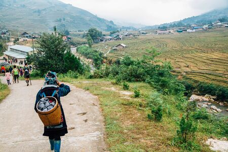 Hmong women and Lao Chai countryside village in Sapa, Vietnam Stock Photo