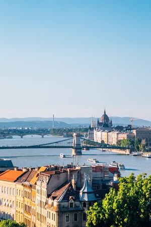 Hungarian Parliament Building and Chain bridge with danube river in Budapest, Hungary