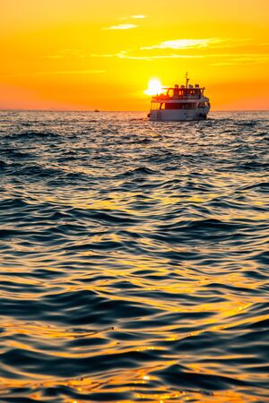 Orange sunset sea and ship in Zadar, Croatia 스톡 콘텐츠